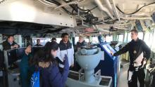 Students on the bridge of a ship